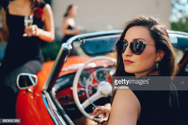 young fashionable girl driving an oldtimer convertible sportscar - high society stock pictures, royalty-free photos & images