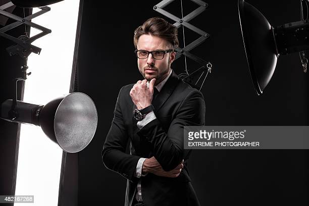 Young fashionable man in photo studio
