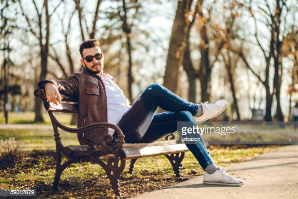 young fashionable man - leather shirt stock pictures, royalty-free photos & images