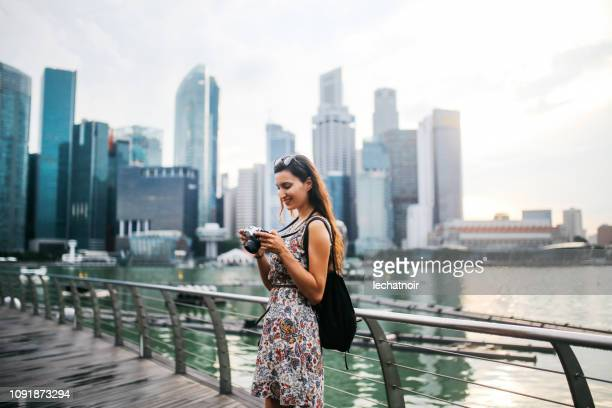 young fashionable solo traveler woman in singapore - asia pac stock pictures, royalty-free photos & images