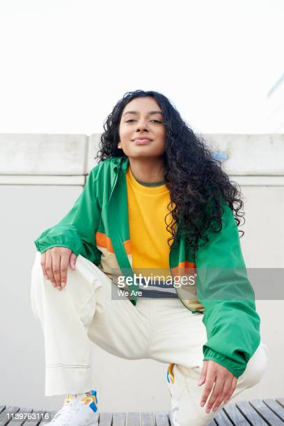 young fashionable woman in city - women's issues stock pictures, royalty-free photos & images