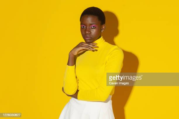 young fashionable woman, total yellow style on yellow background - total look stock pictures, royalty-free photos & images