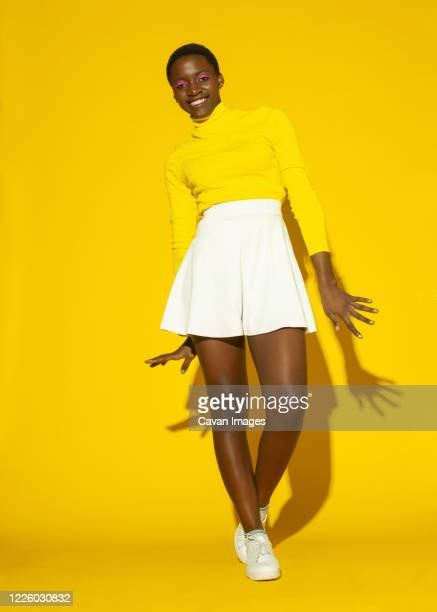 young fashionable woman, total yellow style on yellow background - yellow shoe stock pictures, royalty-free photos & images