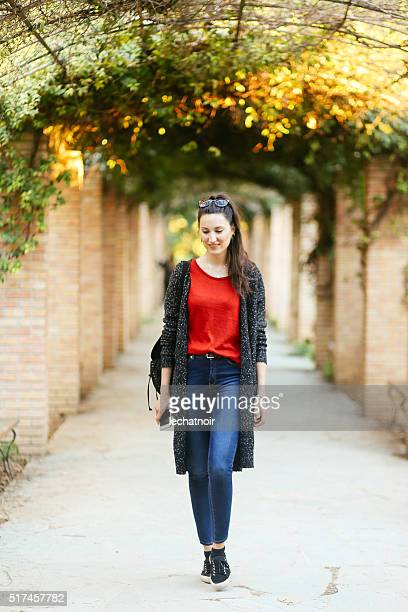 Young fashionable woman walking in the park in Athens, Greece