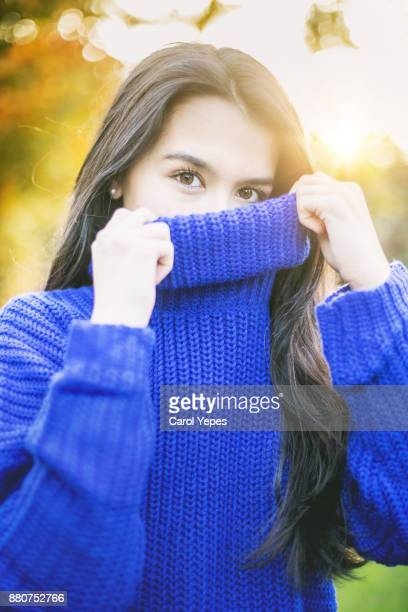 Young Fashionable Woman Wearing a Warm blue sweater outdoors
