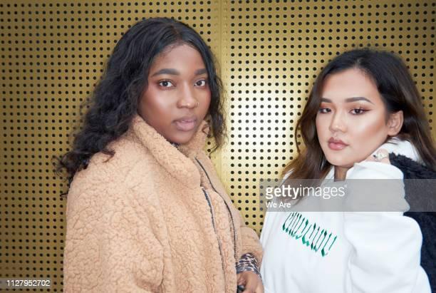 young fashionable women - fleecejas stockfoto's en -beelden