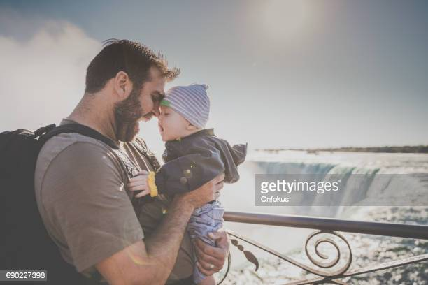 young father and baby boy at niagara falls - niagra falls stock photos and pictures