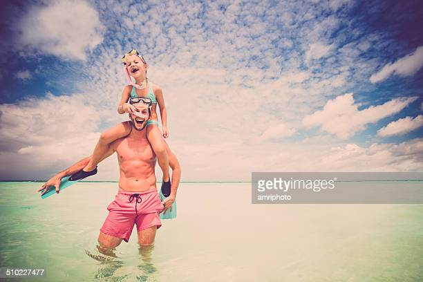 young father and daughter enjoying summer vacation in the water