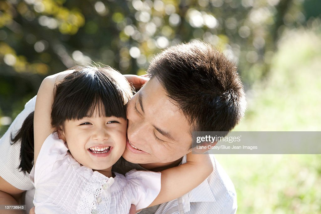 Young father and daughter outdoors : Stock Photo