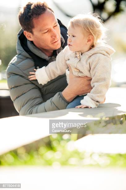young father enjoying toghetherness with his child - waterloo iowa stock pictures, royalty-free photos & images