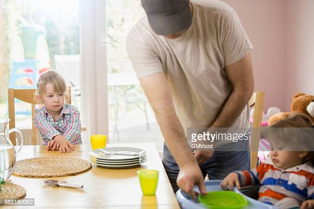 Young Father is Setting Table