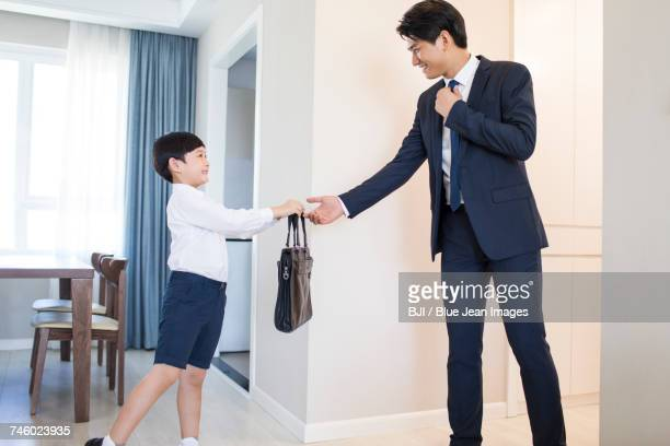 Young father leaving for work