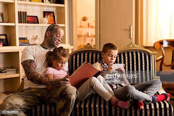 Young father with children relaxing at home.