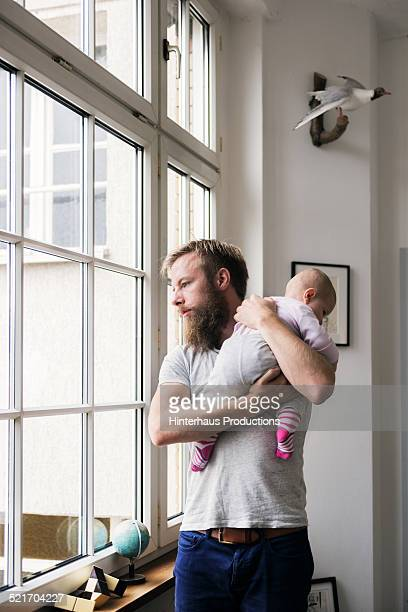Young Father With Newborn Baby