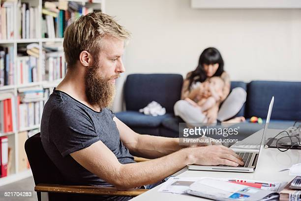 Young Father Working At Home Office