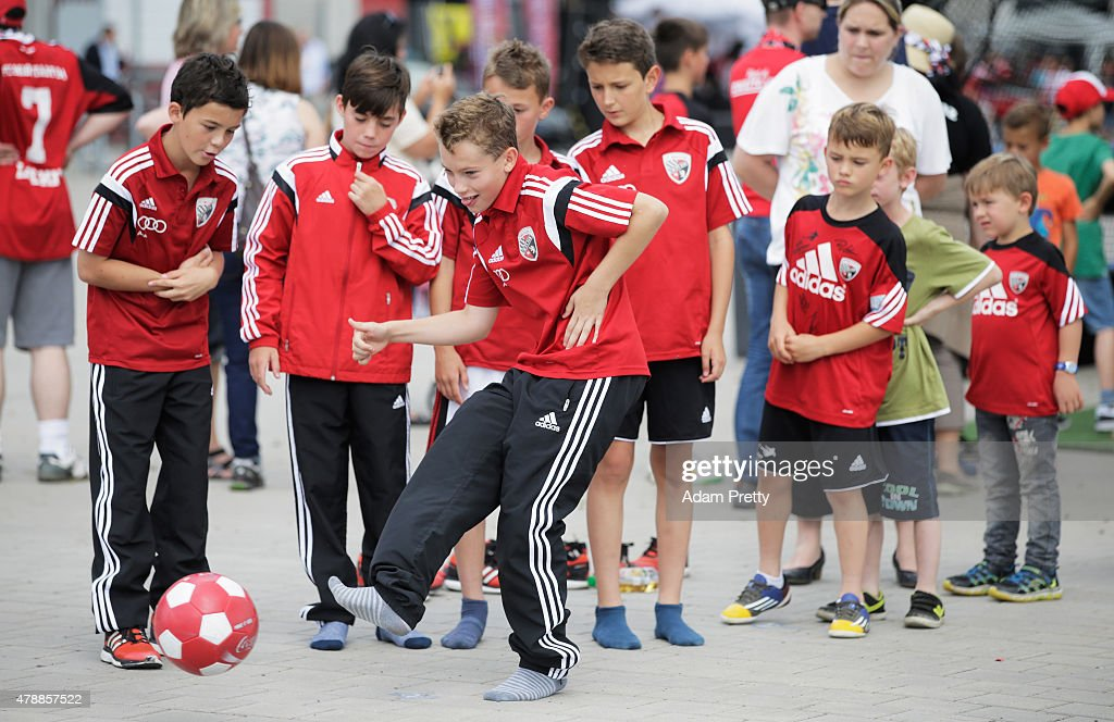 Young FC Ingolstadt fans enjoy the activities on the first day of training at Audi Sportpark on June 28, 2015 in Ingolstadt, Germany.