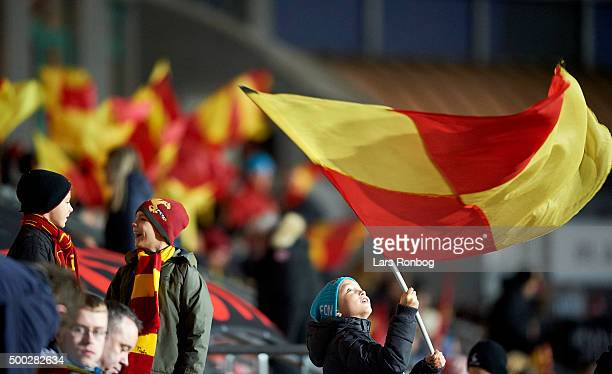 A young FC Nordsjalland fan swings a flag prior to the Danish Alka Superliga match between FC Nordsjalland and Brondby IF at Farum Park on December 6...