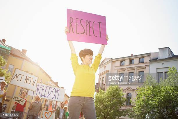 young female activist demonstrating with banner - campaigner stock pictures, royalty-free photos & images