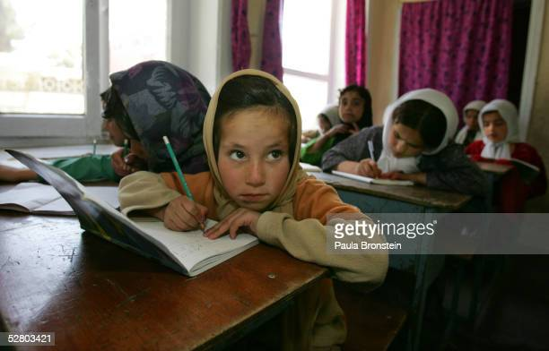 A young female Afghan does her school work with classmates during a math language class at the Aschiana school for street children May 12 2005 in...