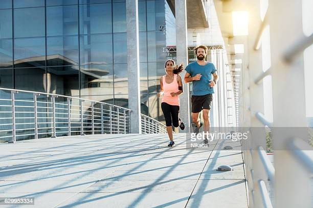 Young female and male jogging
