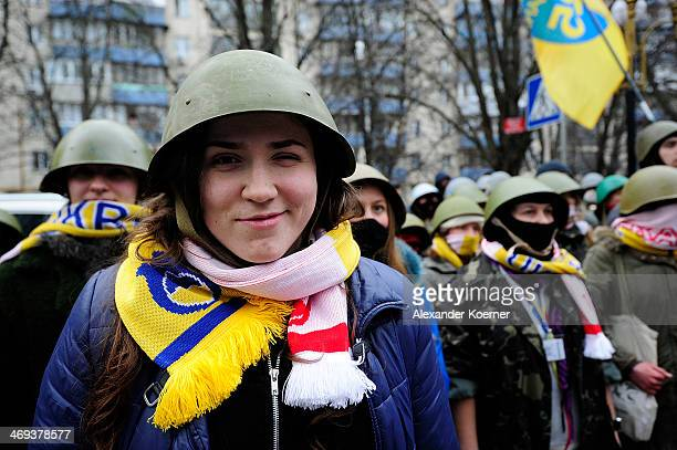 A young female antigovernment protester smiles during a rally on Instytutska Street on February 14 in Kiev Ukraine According to Opposition Officals...