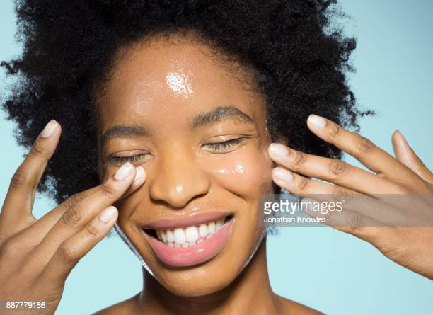 young female applying glossy make-up - woman flashing stock pictures, royalty-free photos & images