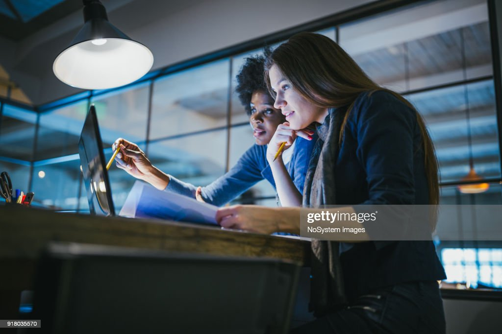 Young female architects working together in architecture studio : Stock Photo