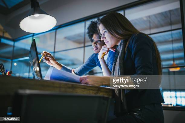young female architects working together in architecture studio - new business stock pictures, royalty-free photos & images