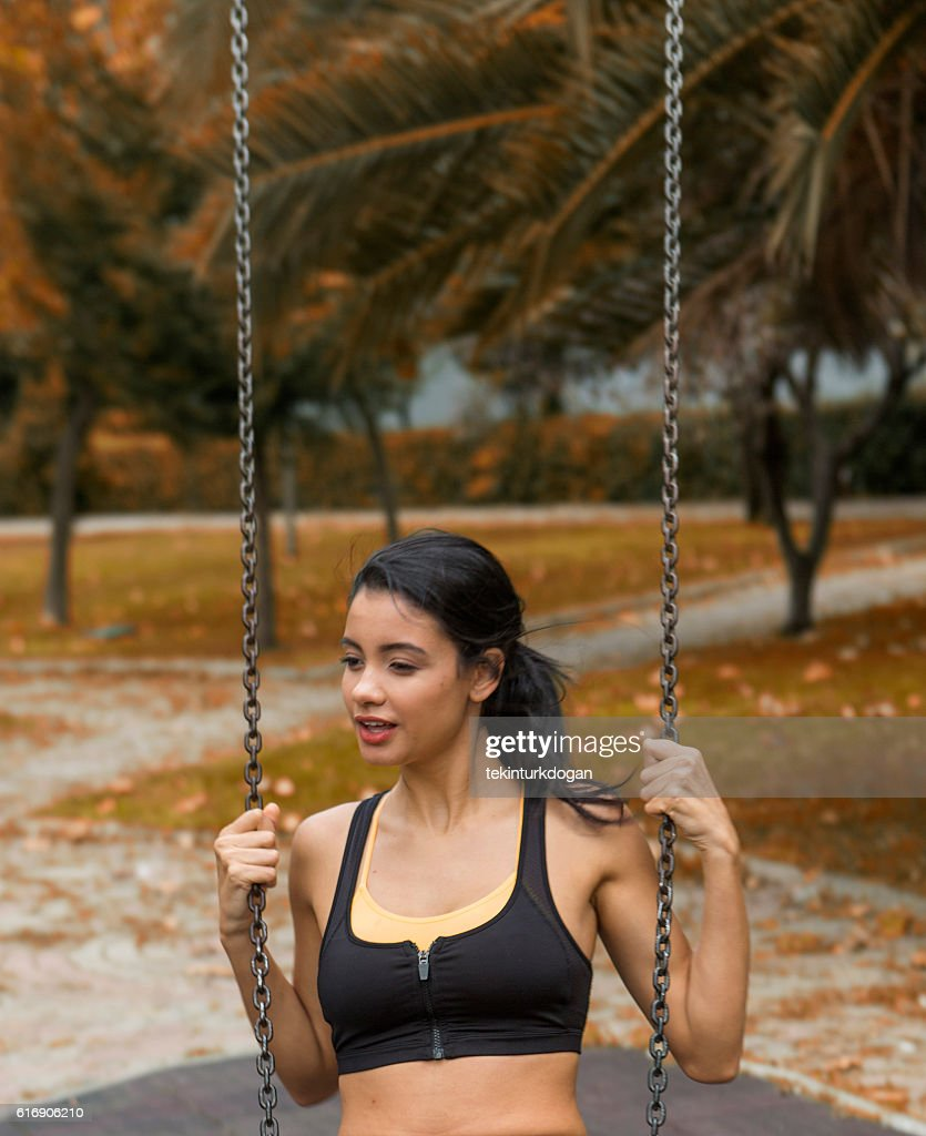 Young female at swing in park of istanbul turkey : Stock Photo