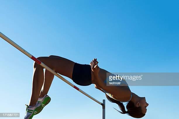 Jeune femme Athlète de saut en hauteur