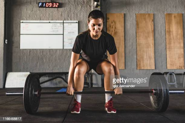 young female athlete practicing weightlifting - execution stock pictures, royalty-free photos & images