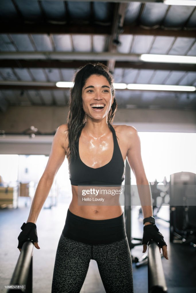 Young female athlete smiling : Stock Photo