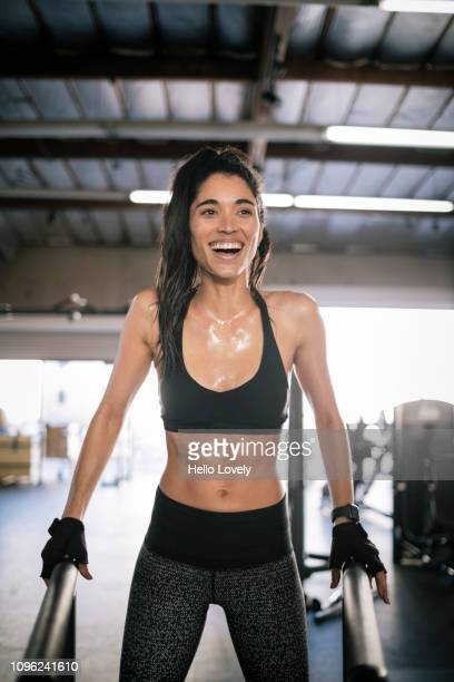 young female athlete smiling - forward athlete stock pictures, royalty-free photos & images
