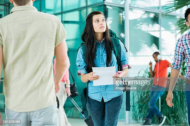 Young female backpacker in airport
