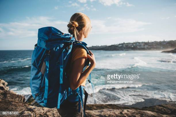 young female backpacker - rucksack stock pictures, royalty-free photos & images