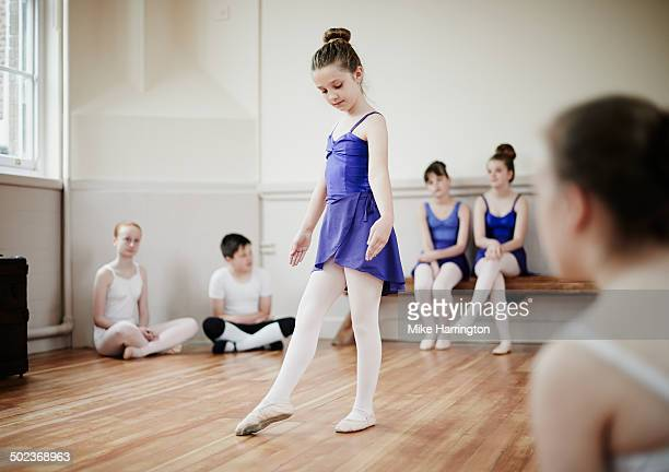 Young female ballet dancer demonstrating pose