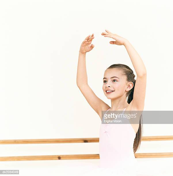 Young, Female Ballet Dancer Practicing in a Dance Studio