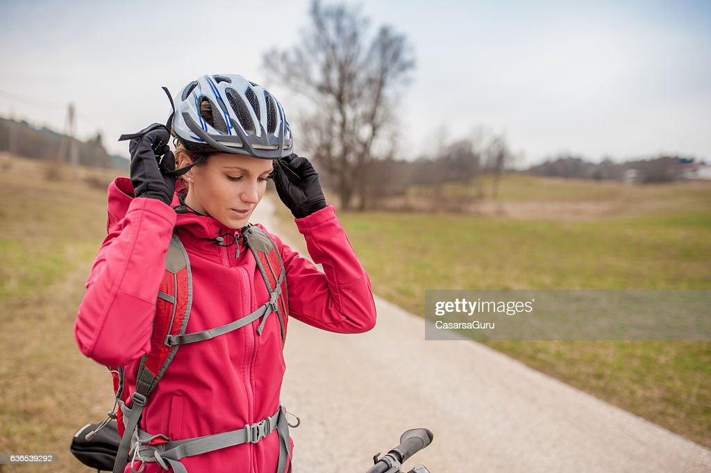 Young Female Biker before Cycling : Stock Photo