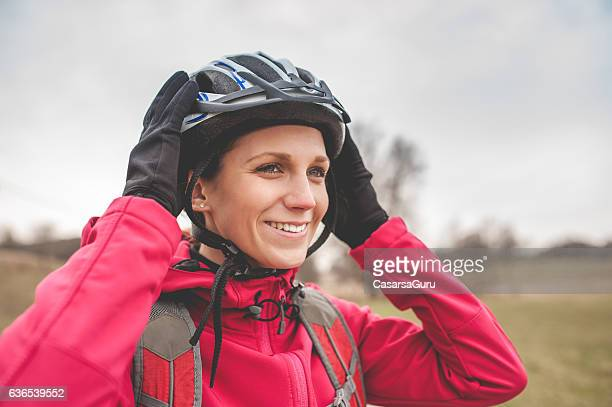 young female biker before cycling - cycling helmet stock photos and pictures