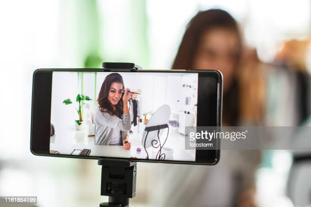 young female blogger doing a live stream - live streaming stock pictures, royalty-free photos & images