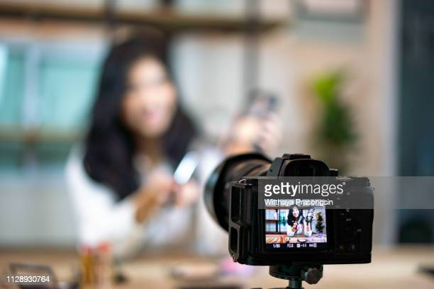 young female blogger on camera screen - tutorial stock pictures, royalty-free photos & images