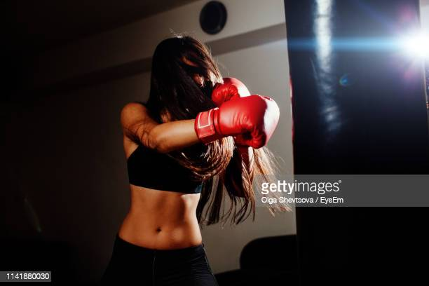 young female boxer practicing in gym - obscured face stock pictures, royalty-free photos & images
