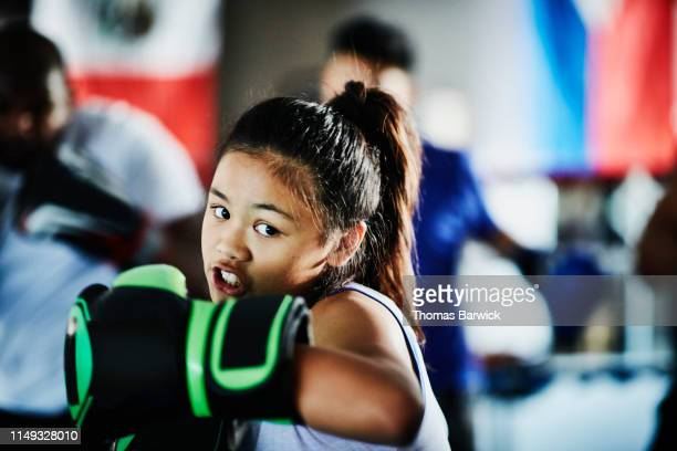 young female boxer shadow boxing while training in gym - extra long stock pictures, royalty-free photos & images
