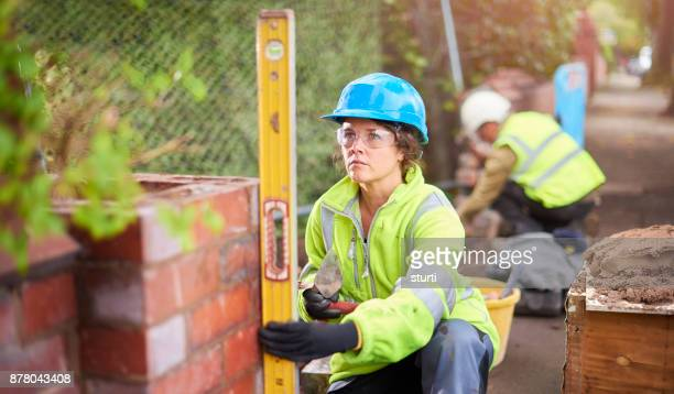 young female bricklayer