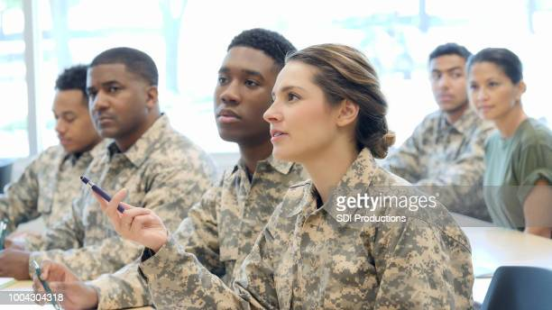 young female cadet asks question in military training class - military stock pictures, royalty-free photos & images