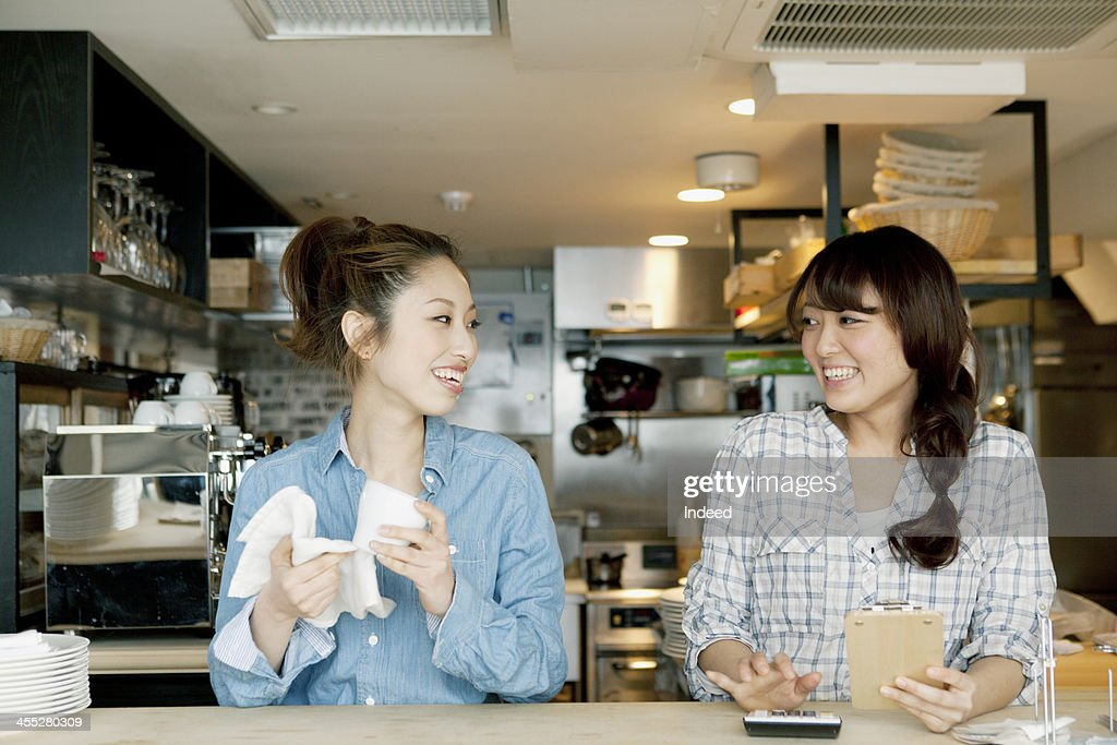 Young female cafe salesclerks : Stock Photo