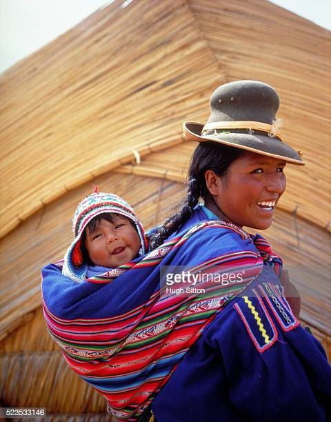 A young female carrying her baby at the body back, Peru
