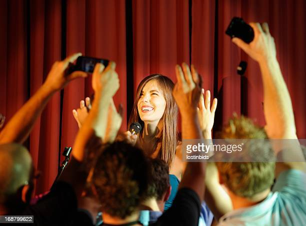 young female celebrity entertaining - stand up comedian stock pictures, royalty-free photos & images