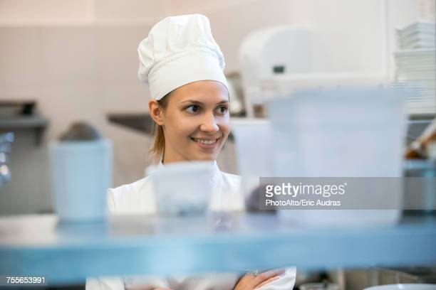 Young female chef in commercial kitchen