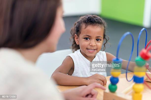 Young female child smiling during her therapy session